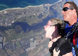 girl doing a tandem skydive