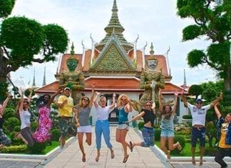 group jumping in front of temple