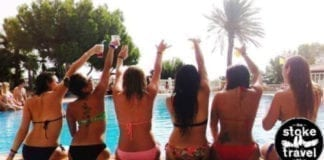 girls sitting in a pool in ibiza