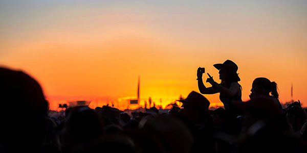 festival crowd with sunset