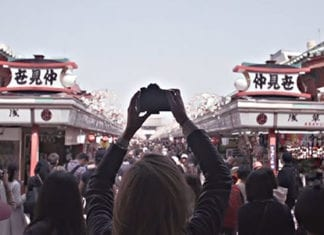 girl taking a photo in japan