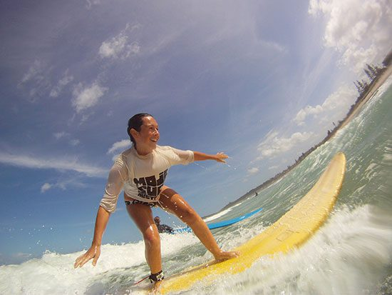 Working Holiday Maker Learning to Surf in Australia